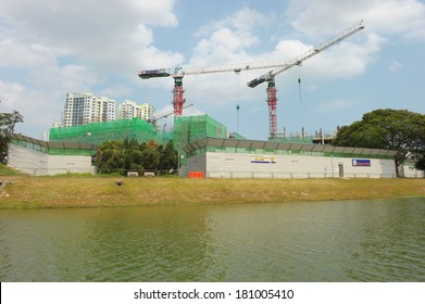 Singapore, Singapore - Feb 25 : Construction with tower cranes for public housing along river bank in the day on Feb 25, 2014