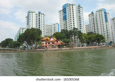 Singapore, Singapore - Feb 25 : High-rise public housing and Chinese temple built along the river bank of Kallang river taken in the day on Feb 25, 2014