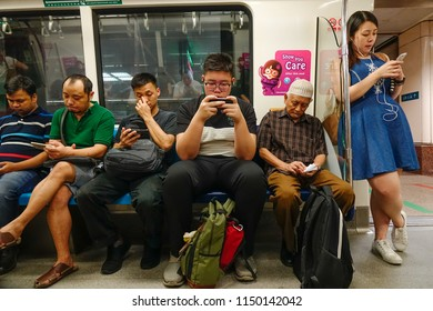 Singapore - Feb 4, 2018. Passengers on train in Singapore. Singapore referred to as the Lion City, is a sovereign city-state in Southeast Asia.