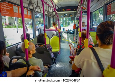 SINGAPORE, SINGAPORE - FEBRUARY 01, 2018: Indoor view of unidentified people inside of a bus, public transport in Singapore