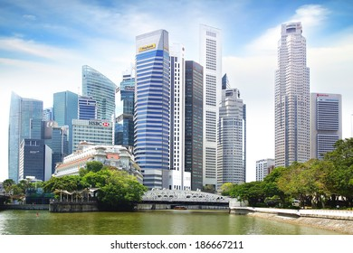 SINGAPORE - FEBRUARY 03, 2014: Singapore skyline with Cavenah Bridge. View includes next buildings: Maybank, Capital Tower, Overseas Bank Plaza, OUB Centre, UOB Plaza One, OSBC, SingTel and ect.
