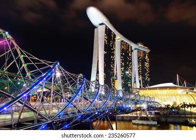SINGAPORE - FEBRUARY 05, 2014: The Helix Bridge, Marina bay sands at night. Marina Bay Sand iconic design has transformed Singapore's skyline. Designed by architect Moshe Safdie.
