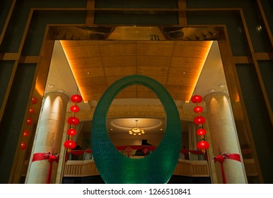 singapore, singapore - february 06, 2017: the lobby of the fullerton hotel in the former singapore general post building with chinese new year decoration