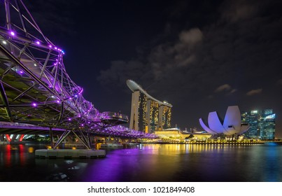Singapore, February 11, 2017. Marina bay sands Hotel from Garden by the bay in Helix bridge to waterfront Marina Bay in Singapore. Spectacular river in Southeast Asia