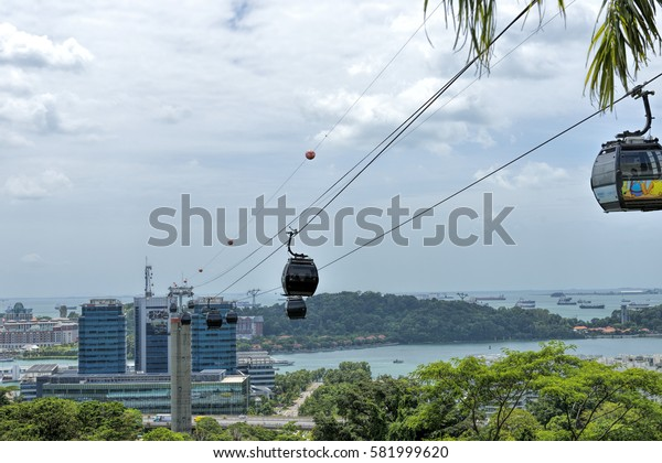 SINGAPORE - FEBRUARY 11: Cable cars from Singapore to Sentosa Island on February 11, 2017 in Singapore. Sentosa is a popular island resort in Singapore with more than 5 million visitors per year.