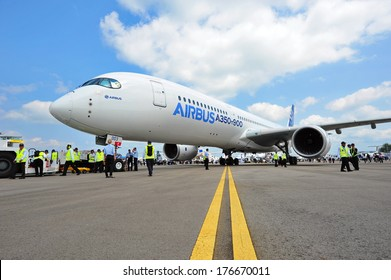 SINGAPORE - FEBRUARY 12: Airbus A350-900 MSN 003 parked for static display at Singapore Airshow February 12, 2014 in Singapore