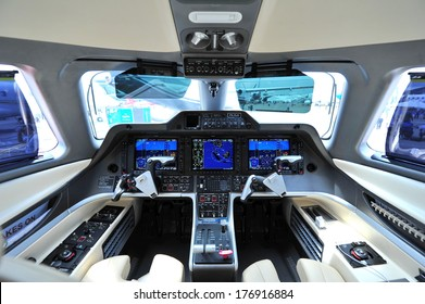 SINGAPORE - FEBRUARY 12: Cockpit of an Embraer Phenom 300 business jet at Singapore Airshow February 12, 2014 in Singapore