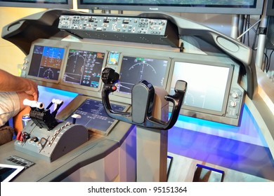 SINGAPORE - FEBRUARY 12: Flight control panel with throttle of Boeing 787 Dreamliner simulator at Singapore Airshow February 12, 2012 in Singapore