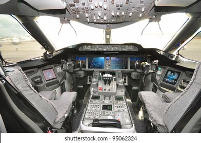 SINGAPORE - FEBRUARY 12: Interior of the cockpit with control panel and throttle in the new Boeing 787 Dreamliner at Singapore Airshow February 12, 2012 in Singapore