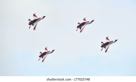 SINGAPORE - FEBRUARY 12: Republic of Singapore Air Force (RSAF) Black Knights performing aerobatics in their F-16 fighter jets at Singapore Airshow February 12, 2014 in Singapore
