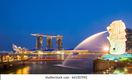 SINGAPORE - FEBRUARY 14, 2015: The Merlion fountain spouts water in front of the Marina Bay Sands hotel in Singapore. Merlion is an imaginary creature, often seen as a symbol of Singapore