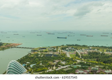 SINGAPORE - FEBRUARY 15, 2017: Aerial view of Singapore gulf and Gardens by the bay from Marina Bay Sands Sky park.