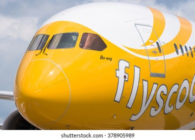 Singapore - February 16, 2016: Front of a Boeing 787-9 Dreamliner in the livery of no frills Singapore airline Scoot during Singapore Airshow at Changi Exhibition Centre in Singapore.
