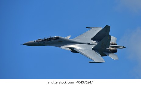 SINGAPORE - FEBRUARY 16:  Royal Malaysia Air Force Sukhoi Su-30MKM fighter performing stunts at Singapore Airshow February 16, 2016 in Singapore