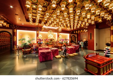 Singapore - February 17, 2017: Interior of the Buddha Tooth Relic Temple and Museum in the Chinatown district. The Buddha Tooth Relic Temple is a popular tourist destination of Asia.
