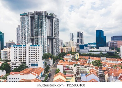 Singapore / Singapore - February 17 2019: Aerial bird's eye view of art deco shophouses along Tanjong Pagar Chinatown Conservation area featuring The Pinnacle Duxton HDB flat