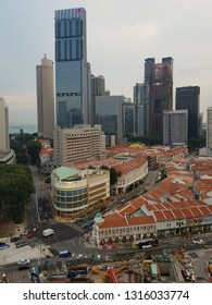 Singapore - February 17 2019: Aerial view of the Singapore business and financial district which contrast with low rise buildings if the historic Chinatown