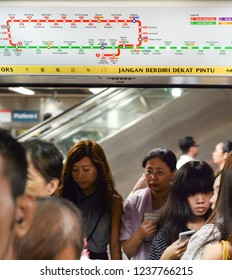 SINGAPORE - FEBRUARY 18, 2017: Passengers boarding train at am metro station in Singapore. The MRT has 102 stations and is the second-oldest metro system in Southeast Asia