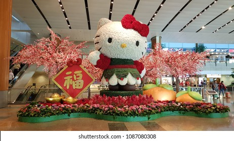 SINGAPORE, FEBRUARY 19,2018 : A big Hello Kitty made from many flowers is  decorated in Terminal 4 at Changi international airport in occasion Chinese New Year.
