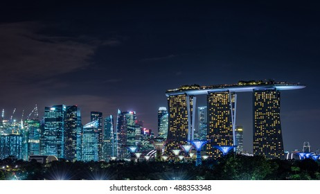 Singapore - February, 2016: Marina bay sands hotel and skyscrapers at  Singapore Marina bay area. Marina Bay is a bay located in the Central Area of Singapore.