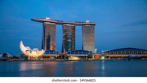 SINGAPORE - FEBRUARY 22: The Marina Bay Sands complex at night on February 22, 2013 in Singapore. Marina Bay Sands is an integrated resort and world's most expensive standalone casino property.
