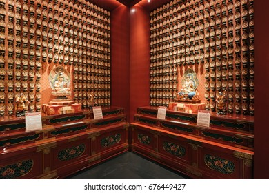 Singapore, Singapore - February 24, 2017: Interior of the  Buddha Tooth Relic Temple and Museum. The temple is a popular attraction within Chinatown.