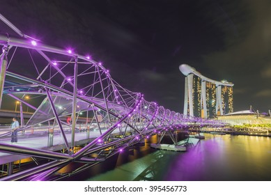 SINGAPORE, FEBRUARY 26 2016 : Singapore cityscape of the Helix Bridge and Marina Bay Sands  on February 26 2016