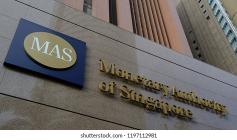 singapore, singapore - february 28, 2018: the front facade of the monetary authority of singapore building with its logo
