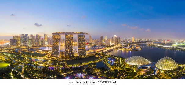 SINGAPORE - FEBRUARY 3: Panorama of Aerial view of Singapore Downtown, Financial district and business centers in urban city. Skyscraper buildings by Drone on February 3, 2020 in Singapore.