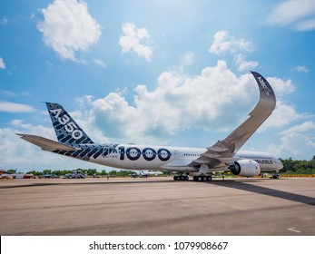 Singapore - February 4, 2018: Airbus A350-1000 XWB in Airbus factory livery during Singapore Airshow at Changi Exhibition Centre in Singapore.