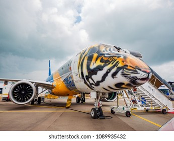 Singapore - February 4, 2018: Embraer E190-E2, with the front section decorated as a tiger head, on display during Singapore Airshow at Changi Exhibition Centre in Singapore.