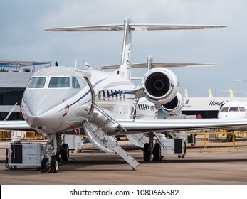 Singapore - February 4, 2018: Gulfstream G550 business jet on display during Singapore Airshow at Changi Exhibition Centre in Singapore.