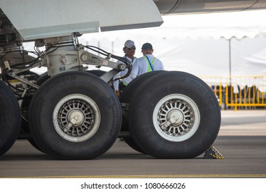 Singapore - February 4, 2018: Main landing gear of Airbus A350-1000 XWB in Airbus factory livery during Singapore Airshow at Changi Exhibition Centre in Singapore.
