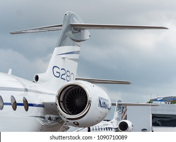Singapore - February 4, 2018: Tail planes and engines of Gulfstream G280 and G650ER business jets on display during Singapore Airshow at Changi Exhibition Centre in Singapore.
