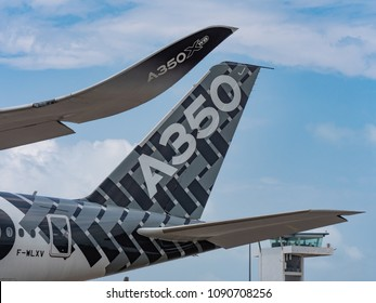 Singapore - February 4, 2018: Winglet and tailplane of Airbus A350-1000 XWB in Airbus factory livery during Singapore Airshow at Changi Exhibition Centre in Singapore.