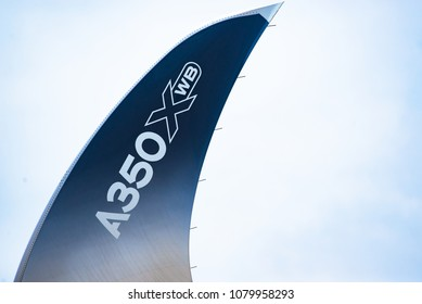 Singapore - February 4, 2018: Wingtip device, or winglet, of an Airbus A350-1000 XWB in Airbus factory livery during Singapore Airshow at Changi Exhibition Centre in Singapore.