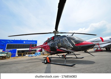 SINGAPORE - FEBRUARY 9: Bell 407GX helicopter on display at Singapore Airshow February 9, 2014 in Singapore