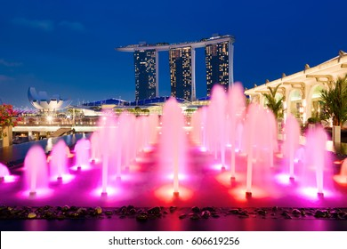 Singapore, Singapore - February22, 2017: Marina Bay Sands and a colorful fountain at night in Singapore.