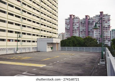 Singapore, Singapore - Jan 02 : Multi-storey carpark with new and old Singapore public housing (HDB) in the same estate taken in the day on Feb 02, 2015