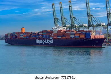 SINGAPORE, SINGAPORE - Jan 06, 2017: Hapag-Lloyd container ship ULSAN EXPRESS arrival to Port of Singapore container cargo terminal, one of the busiest shipping terminals in the world, Keppel Harbour.