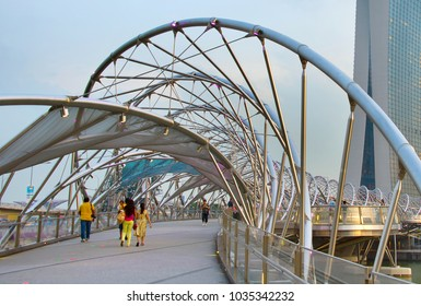 SINGAPORE - JAN 13, 2017: Helix bridge and Marina Bay Sands Resort at twilight in Singapore.