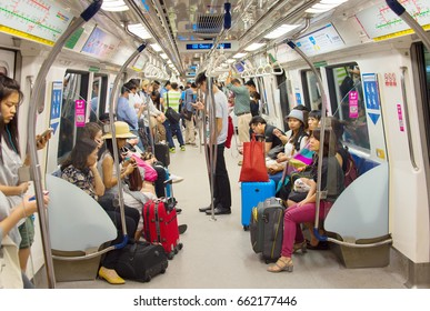 SINGAPORE - JAN 13, 2017: Passengers in Singapore Mass Rapid Transit (MRT) train. The MRT has 102 stations and is the second-oldest metro system in Southeast Asia