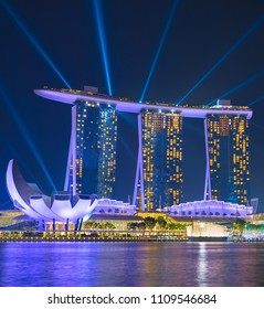 SINGAPORE - JAN 14, 2017: Marina Bay Sands Resort performing lights show at night. It is billed as the world's most expensive standalone casino property at S$8 billion