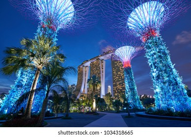 SINGAPORE - JAN 16, 2018 - Marina Bay Sands Hotel and Gardens By The Bay illuminated at dusk