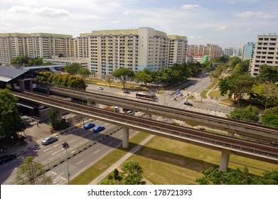 Singapore, Singapore - Jan 29 : Singapore MRT train station along a cross junction in a new neighbourhood town taken in the day on Jan 29, 2014