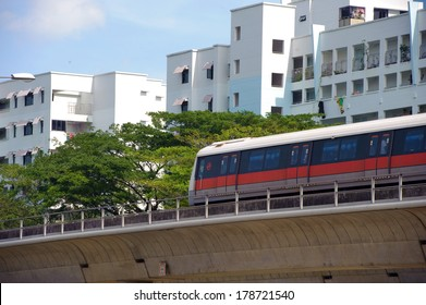 Singapore, Singapore - Jan 29 : Singapore MRT train passing by a neighbourhood town taken in the day on Jan 29, 2014