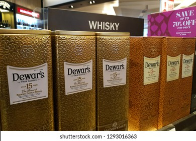 SINGAPORE - JAN 4, 2019: Dewar's blended scotch whisky on whisky store shelf of Changi Airport New Terminal 2. Dewar's is a brand of blended Scotch whisky owned by Bacardi.