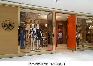 SINGAPORE - JAN 4, 2019: The outer facade of the Tory Burch boutique in Orchard Paragon Mall. Tory Burch is an American fashion label owned, operated and founded by American designer Tory Burch.