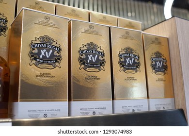 Singapore - JAN 6, 2019: Chivas Regal XV Blended Scotch Whisky on display shelf in Changi Airport Terminal. Chivas Regal is a blended Scotch whisky produced by Chivas Brothers.