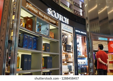 Singapore - JAN 6, 2019: Interior view of various brand of whiskey display on store shelf in Changi Airport. Whiskey is a type of distilled alcoholic beverage made from fermented grain mash.